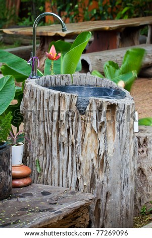 Sink is made of old wood in the garden. - stock photo