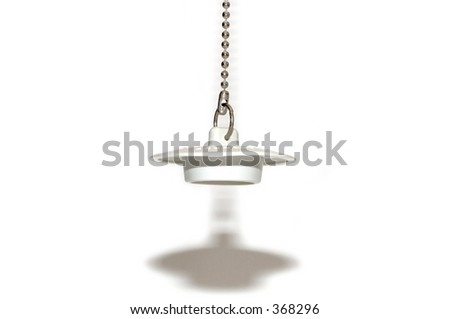 Sink plug with chain over white background.