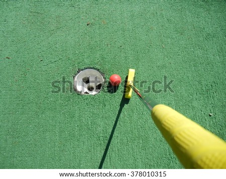 Sink the putt. - stock photo