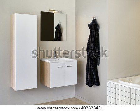 Sink vanity with furniture and bathrobe on the side. - stock photo