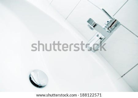 Sink with faucet and drain - stock photo