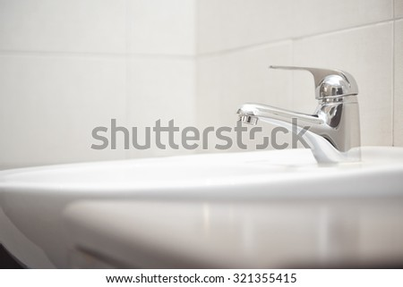 Sink with water tap. Close-up horizontal photo - stock photo