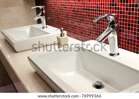 sinks and taps in a public toilet