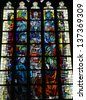 SINT TRUIDEN, BELGIUM - APRIL 24: Stained glass window depicting the Last Supper in the church of Our Lady in Saint Truiden, Belgium on April 24, 2013. - stock photo
