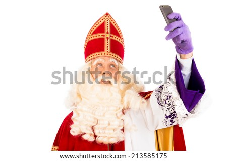 Sinterklaas  making selfie with mobile. isolated on white background. Dutch character of Santa Claus - stock photo