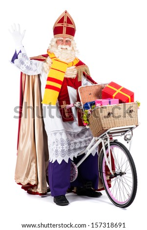 Sinterklaas on a bike, going to bring presents to the children