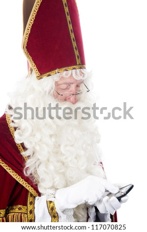 Sinterklaas using a mobile phone - stock photo
