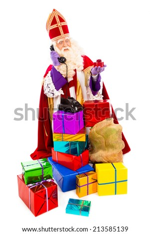 Sinterklaas with presents and old vintage telephone. isolated on white background. Dutch character of Santa Claus - stock photo