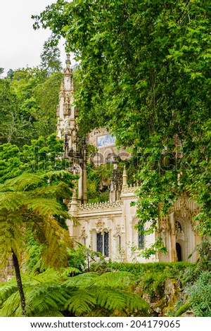 SINTRA, PORTUGAL - JUN 22, 2014: Regaleira Chapel, a Roman Catholic Chapel on the territory of the Quinta da Regaleira estate, Sintra, Portugal. UNESCO World heritage