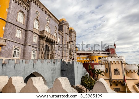 """SINTRA, PORTUGAL - SEPTEMBER 9, 2015: Popular tourist destination the Royal Palace of Pena, or """"Castelo da Pena"""" as it is more commonly known, Portugal, Sintra.  - stock photo"""