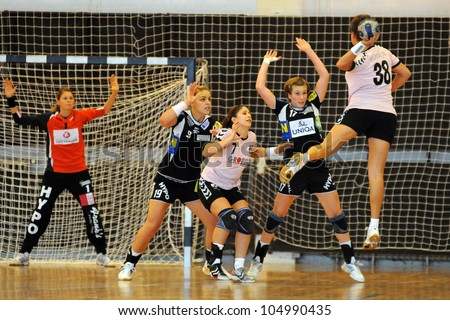SIOFOK, HUNGARY - AUGUST 24: Unidentified players in action at a Siofok Cup handball game Siofok KC pink (HUN) vs. HYPO NO blue (AUT) August 24, 2008 in Siofok, Hungary. - stock photo