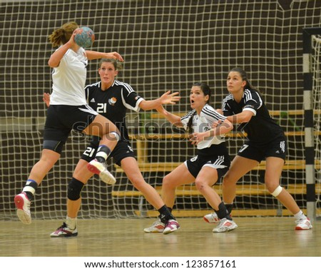 SIOFOK, HUNGARY - JANUARY 5: Unidentified players in action at a Hungarian National Championship handball match Siofok KC (black) vs. Budapest SE (white) January 5, 2013 in Siofok, Hungary. - stock photo
