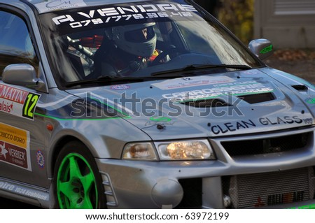 SION, SWITZERLAND - OCTOBER 28: Scheidegger and Trombert on Day 1, Stage 1 of the International Rally of the Valais in a Mitsubishi Evo on October 28, 2010 in Sion Switzerland