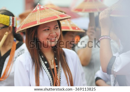 Sipitang Sabah Malaysia - August 30, 2014 : Lundayeh lady in their traditional costume during festival call  GATA in Sipitang Sabah. Lundayeh tribe is one of Sabah ethnic reside in the interior.