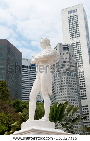 Sir Raffles statue with modern skyscrapers on background, Singapore