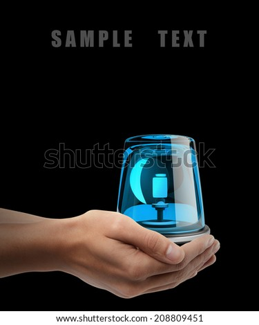 siren. Man hand holding object isolated on black background. High resolution  - stock photo