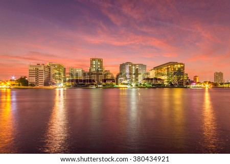 Siriraj Hospital, Public Hospital at twilight time in the river, Bangkok, Thailand - stock photo
