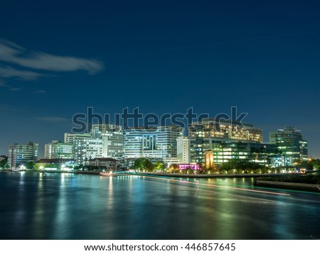 Siriraj hospital, the first medical school in Thailand, buildings located along Chaophraya river in Bangkok, Thailand, under twilight cloudy evening sky