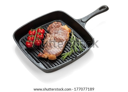 Sirloin steak with rosemary and cherry tomatoes cooking in a frying pan. Isolated on white background - stock photo