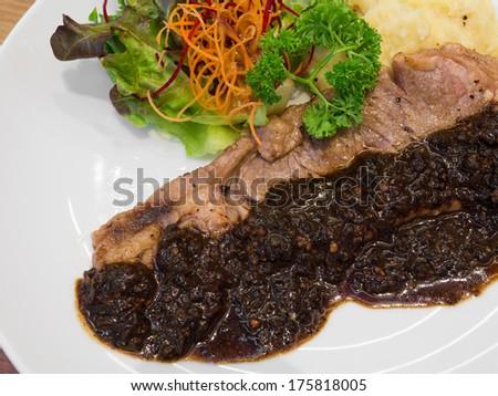 Sirloin steak with sauce - stock photo