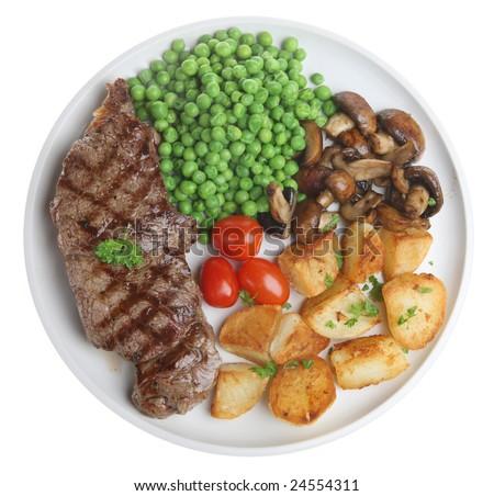 Sirloin steak with sauteed potatoes, mushrooms and peas - stock photo