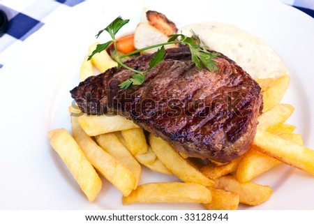 Sirloin strip Steak -entrecote- with vegetables and savory bechamel-sauce - stock photo