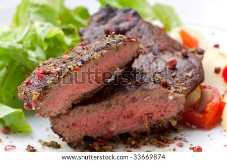 sirloin strip steak with boiled potato - stock photo