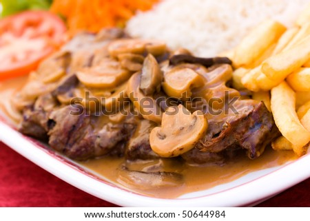 sirloin strip steak with french fries and rice - stock photo