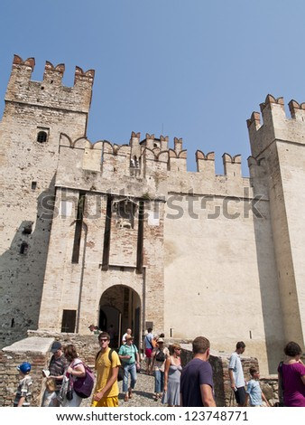 SIRMIONE - AUG 20 : Unidentified tourists out of the castle, on August 20, 2009 in Sirmione,Lago Garda, Italy.The Scaliger Castle is considered one of the finest examples  medieval fortification.