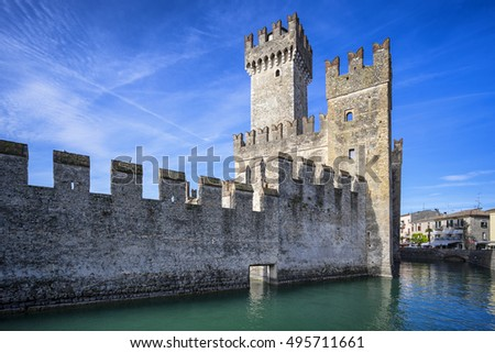 Sirmione, Italy - August 12, 2016: Medieval castle Scaliger in old town Sirmione on lake Lago di Garda. Italy