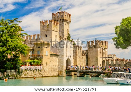 SIRMIONE, ITALY - JUNE 1, 2014: The Scaliger Castle in Sirmione, Italy, June 1, 2014. Surrounded by the water, the Scaliger Castle is considered one of the finest examples of medieval fortification. - stock photo