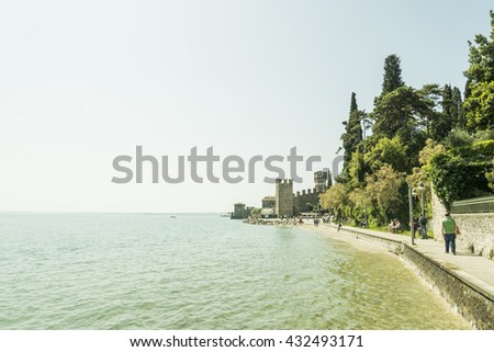 Sirmione, Italy - May 22, 2016: scenic walk along the lake to si