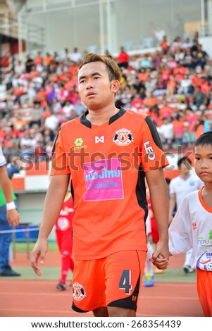 SISAKET THAILAND-APRIL 4: Anucha suksai (No.4) of Sisaket FC. befor start Thai Premier League between Sisaket FC and Thai Port FC at Sri Nakhon Lamduan Stadium on April 4,2015,Thailand