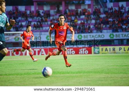 SISAKET THAILAND-JULY 4: Kittipong Wongma (orange) of Sisaket FC. in action during  Thai Premier League between Sisaket FC and Chainat Hornbill FC at Sri Nakhon Lamduan Stadium on July 4,2015,Thailand - stock photo