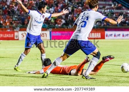 SISAKET THAILAND-JULY 23: Players of Songkhla Utd. (white) in action during Thai Premier League between Sisaket FC and Songkhla Utd at Sri Nakhon Lamduan Stadium on July 23,2014,Thailand - stock photo