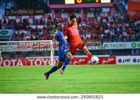 SISAKET THAILAND-JUNE 21: Kittipong Wongma (orange) of Sisaket FC. in action during  Thai Premier League between Sisaket FC and Navy FC at Sri Nakhon Lamduan Stadium on June 21,2015,Thailand - stock photo