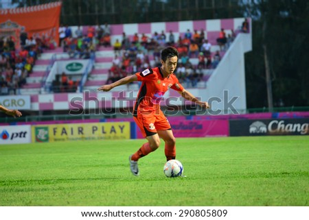SISAKET THAILAND-JUNE 21: Nuttawut Khamrin (orange) of Sisaket FC. in action during  Thai Premier League between Sisaket FC and Navy FC at Sri Nakhon Lamduan Stadium on June 21,2015,Thailand - stock photo