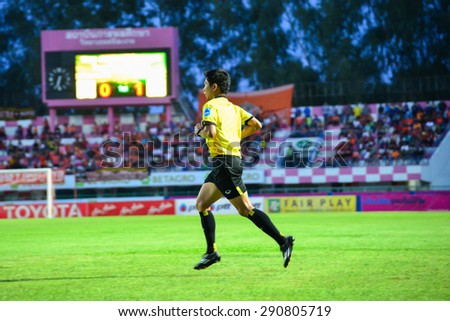 SISAKET THAILAND-JUNE 21: referee on soccer match during Thai Premier League between Sisaket FC and Navy FC at Sri Nakhon Lamduan Stadium on June 21,2015,Thailand - stock photo