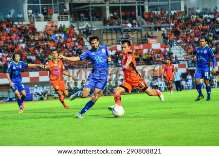 SISAKET THAILAND-JUNE 21: Tatree Siha (orange) of Sisaket FC. in action during  Thai Premier League between Sisaket FC and Navy FC at Sri Nakhon Lamduan Stadium on June 21,2015,Thailand - stock photo