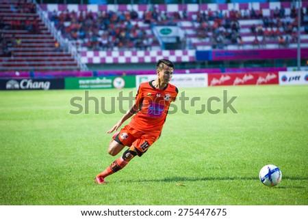 SISAKET THAILAND-MAY 3: Jakkapong Somboon (orange) of Sisaket FC. in action during Thai Premier League between Sisaket FC and Chiang rai united at Sri Nakhon Lamduan Stadium on May 3,2015,Thailand - stock photo