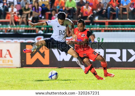 SISAKET THAILAND-SEPTEMBER 16: Jirawat Daokhao of Sisaket FC. (orange) in action during Thai Premier League between Sisaket and Pattaya Utd at Sri Nakhon Lamduan Stadium on September 16,2015,Thailand