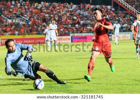 SISAKET THAILAND-SEPTEMBER 20: Theerachai Ngamcharoen of Sisaket FC (orange) in action during Thai Premier League between Sisaket and TOT SC at Sri Nakhon Lamduan Stadium on September 20,2015,Thailand - stock photo