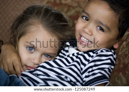 Sister and brother embracing - stock photo