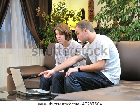 sister and brother in front of computer