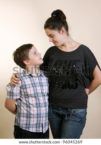 Sister and brother looking at each other - stock photo