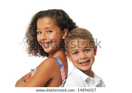 Sister and brother smiling isolated on white