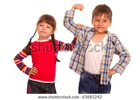 Sister checking her brother muscles