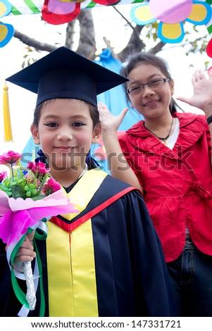 Sister Congratulations Kindergarten graduation. - stock photo