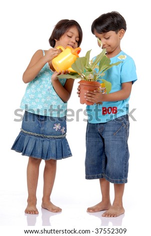 Sister helping brother in watering the plant over white background - stock photo