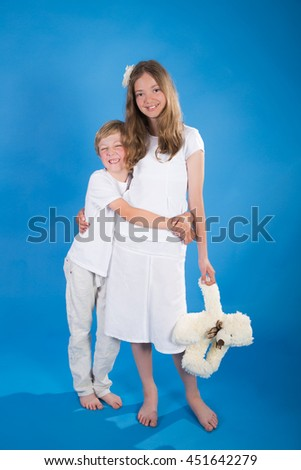 sister of brothers playing on blue background bears - stock photo